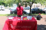 Justin James gives out information for the University of Maryland medical system at a Baltimore block party. (Photo by Tramon Lucas)