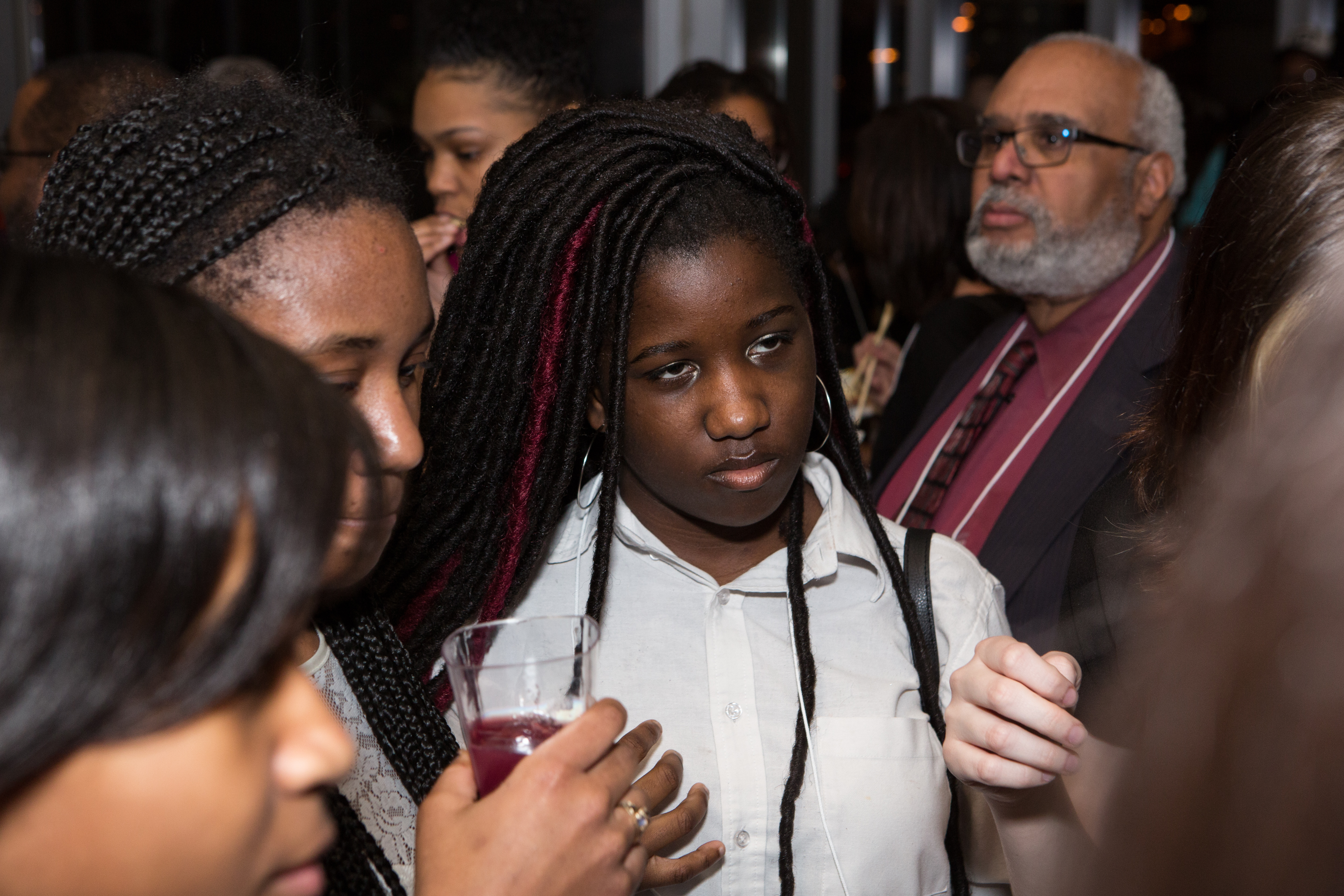 Students mingle with guests at the kickoff party.