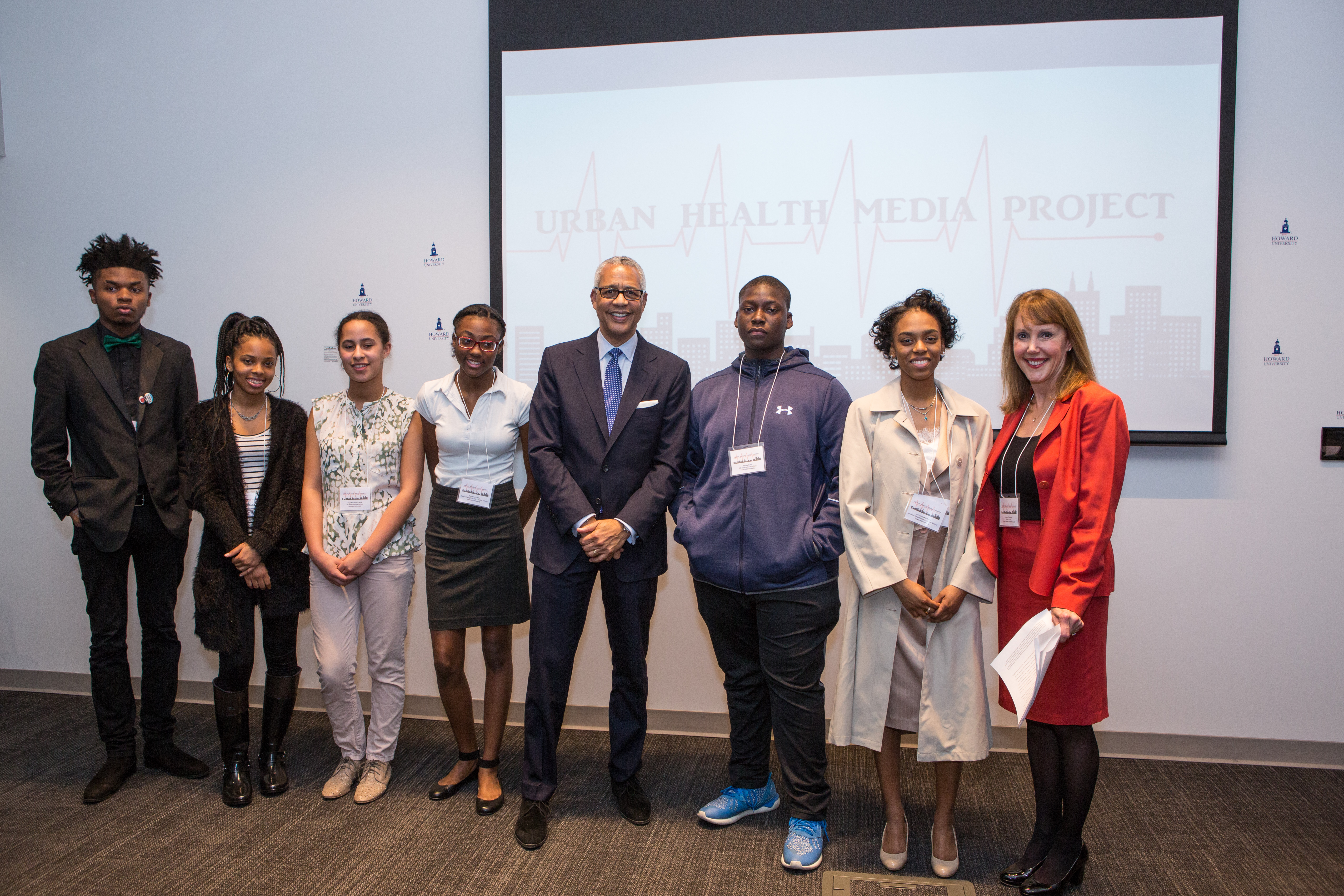 Dr. Tuckson and O'Donnell take photos with first class of UHMP students.