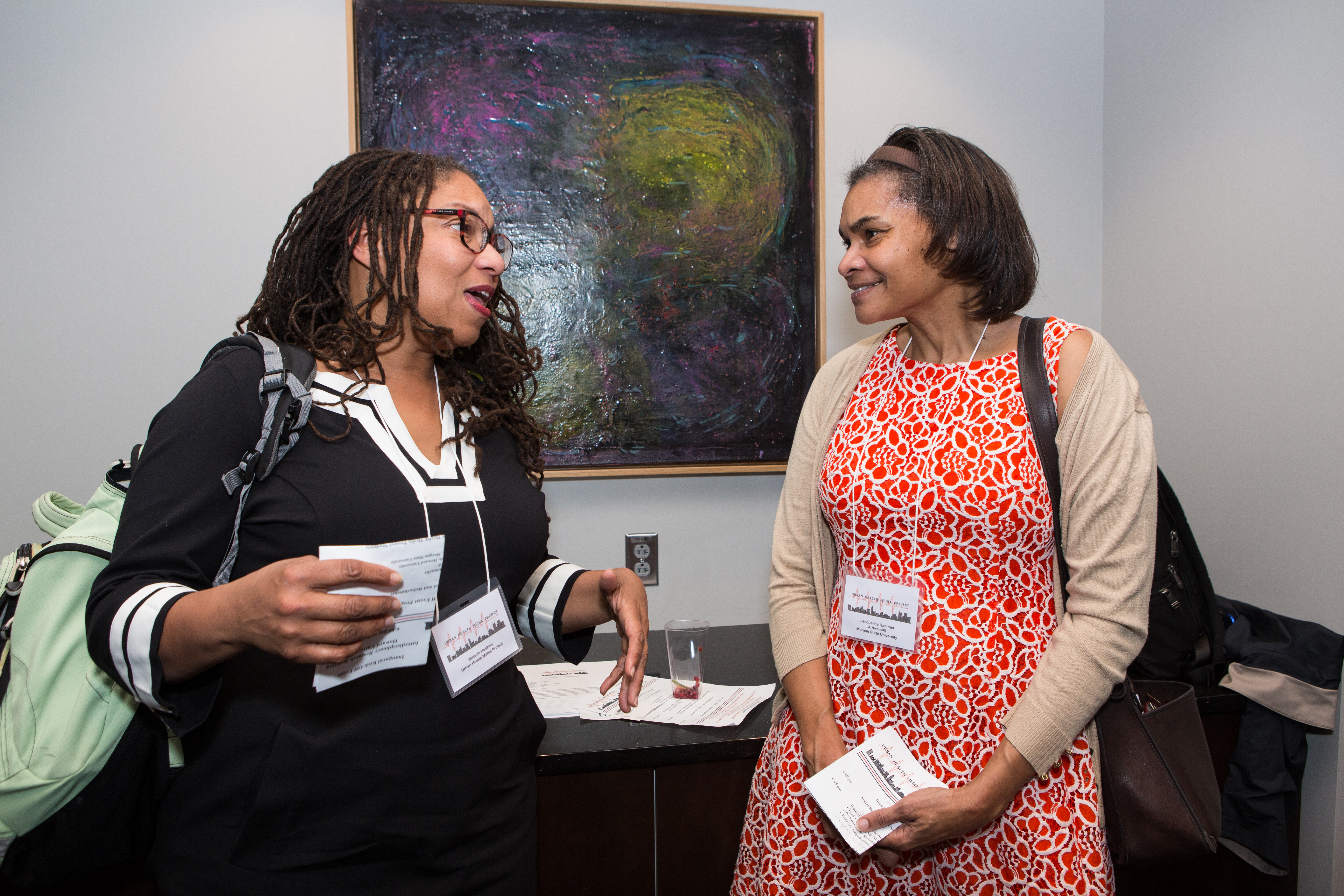 Nichele Hoskins, an instructor in UHMP2017, greets guests.
