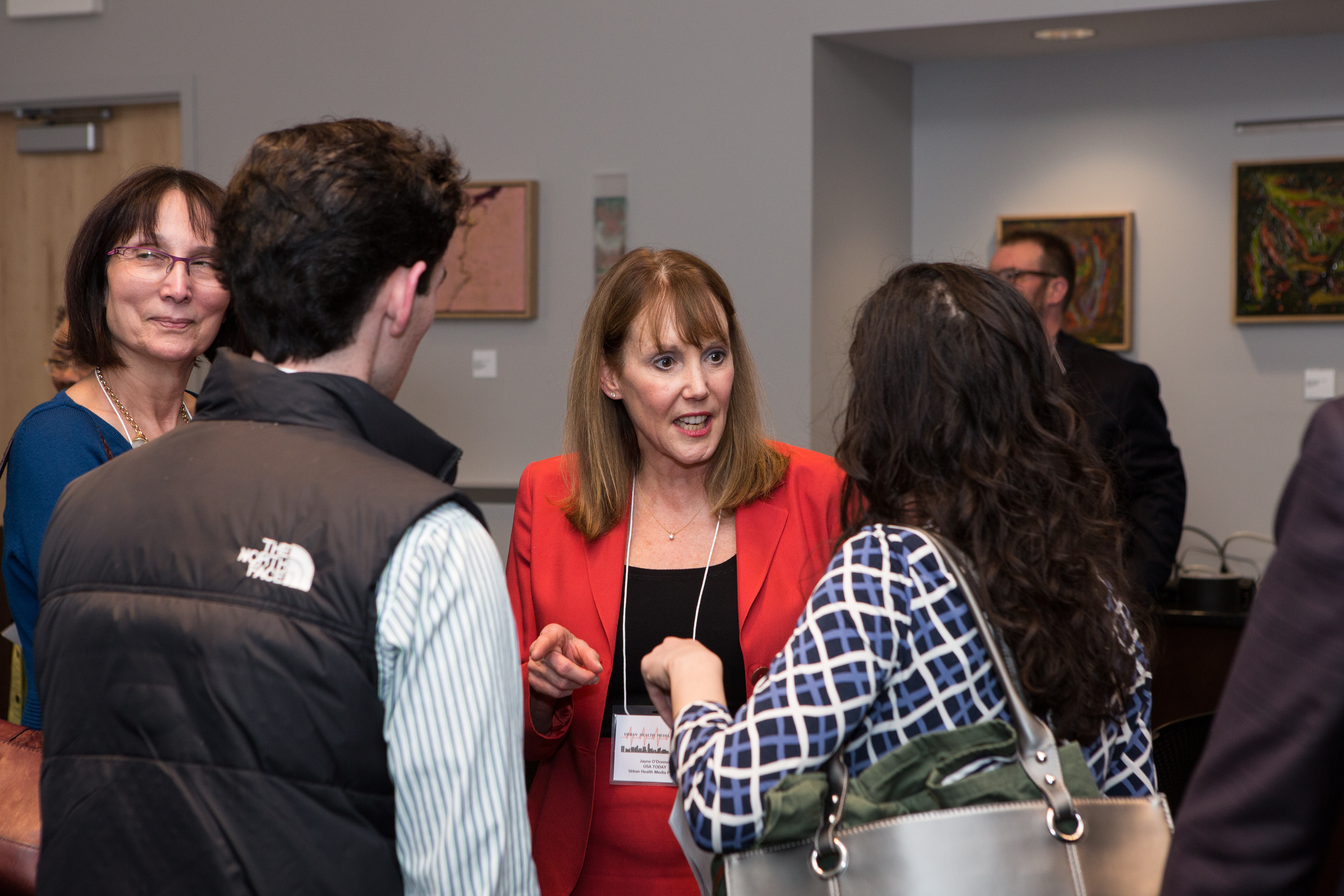 Jayne O'Donnell, cofounder and director of the Urban Health Media Project, greets guests at launch party.