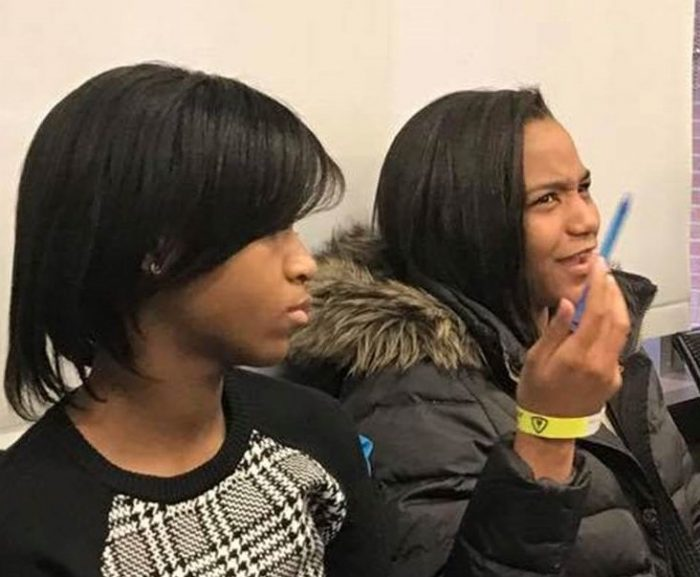 Asha Davis, left, is shown during a presentation at Johns Hopkins hospital with, l to r, Urban Health Media Project students Erin Burnett, Riley Johnson, Xela Wooten and guest, Baltimore Sun reporter Sarah Meehan
